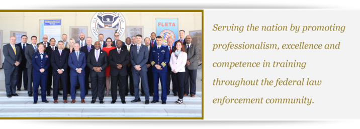 2018 photo of the FLETA Board of Directors with text to the right: Serving the nation by promoting professionalism, excellence, and competence in training throughout the federal law enforcement community