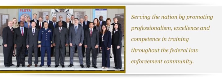 2019 photo of the FLETA Board of Directors with text to the right: Serving the nation by promoting professionalism, excellence, and competence in training throughout the federal law enforcement community