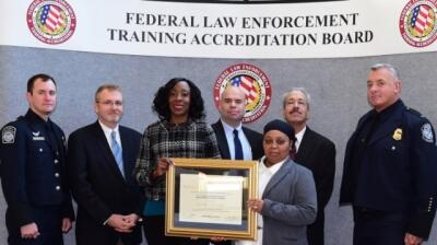 CBP and USDA staff accept the certificate of accreditation for the CBPAS.