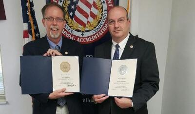 CJ Ross and Joseph M. Collins with their service awards