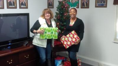 FLETA Program Analysts Liz Dodson and Stephanie Archbold prepare the gifts to present to CASA.
