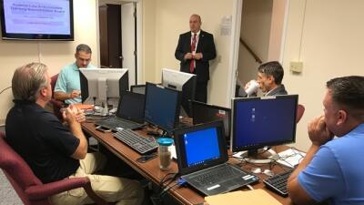 Executive Director Joe Collins welcomes the FLETA Board inspection team