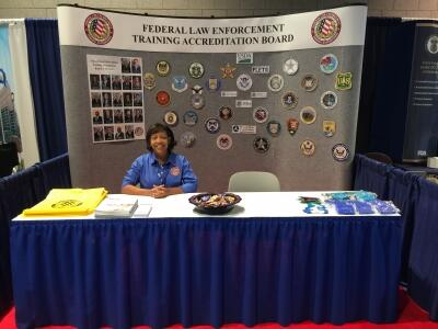 Stephanie Archbold works the FLETA Booth at IACP