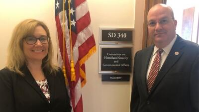 Jennifer Kasper and Joe Collins outside Senate Committee Auguast 29, 2019