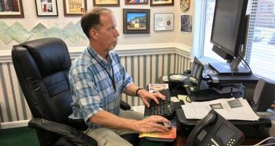 FLETA Program Manager CJ Ross at his computer