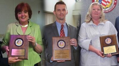 Three previous FLETA Team Leaders hold their plaques